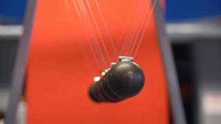 Newton's cradle showing laws of physics in motion 4k
