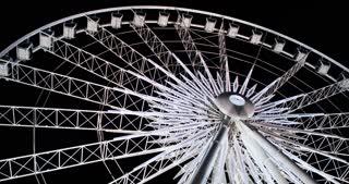 Niagara Skywheel rotating on night sky 4k.