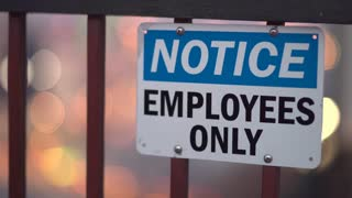 Notice Employees Only sign with city lights in background 4k