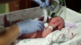 Nurse checking newborn babies dimensions