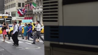 NYC pedestrians crossing street in slow motion