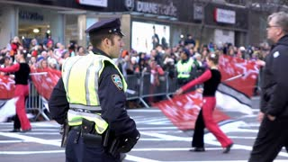 NYC Police officers standing guard alongside Macys Parade 2015 4k