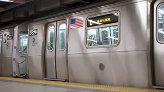 NYC subway train leaving station 4k