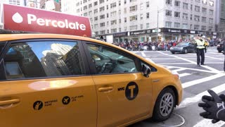 NYC Taxi stopped in traffic of Macys Parade 2015 4k