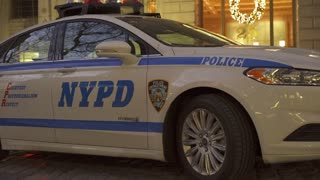 NYPD car sitting in downtown business district of New York City 4k