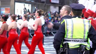 NYPD officer standing along side marching band in Macys Parade 4k