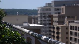 Office building balcony overlooking city 4k