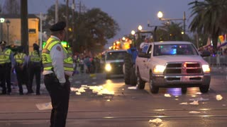 Officer standing on Endymion route in night lights