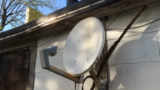 Old Satellite dish on side of house