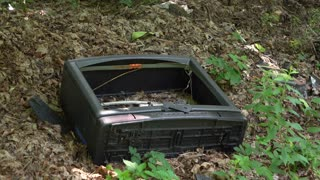 Old television in woods with broken screen 4k