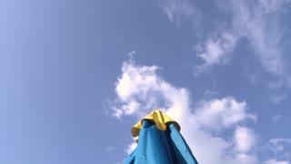 Opening Umbrella on Sunny Day