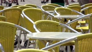 Outdoor restaurant chairs in sunshine