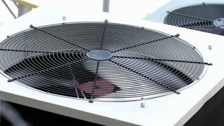 Outside Air Conditioner fan blade spinning