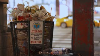 Overflowing trash bin in New York City 4k