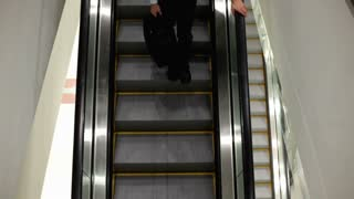 Overhead view of Person going down escalator