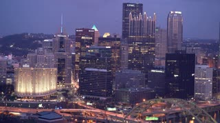 Overview of downtown Pittsburgh buildings at night 4k