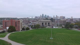 Overview of Kansas City with American Flag in field 4k