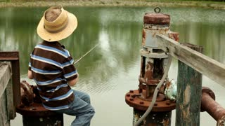 Pan of Boy on dock fishing