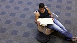 Pan of Student studying in chair
