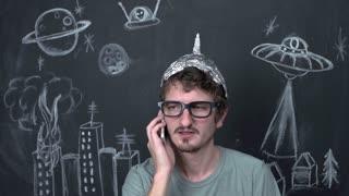 Paranoid alien conspiracy theorist on phone