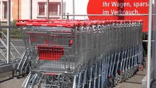 Parked super market shopping carts in parking lot 4k
