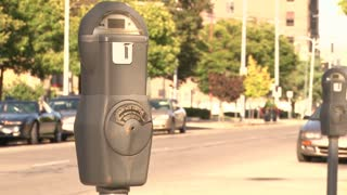 Parking Meter with Cars Driving By