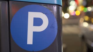 Parking sign at night in busy city 4k