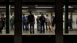 Passengers enter and exit subway train in station of New York City 4k