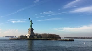 Passing by Statue of Liberty seen from boat tour 4k