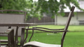 Patio furniture in rainfall slow motion