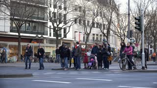 Pedestrians at Crosswalk in downtown Cologne Germany 4k