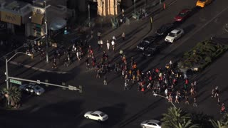 Pedestrians crossing street in Las Vegas seen from above 4k