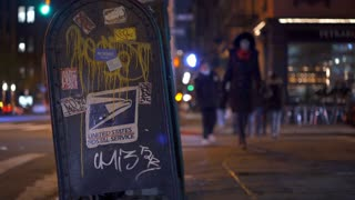 Pedestrians in New York city walking by postal service box 4k