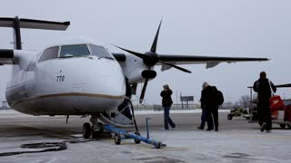 People boarding Propeller Plane in Cleveland