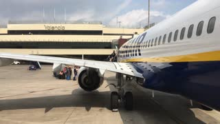 People boarding Ryanair plane in Valencia Spain 4k