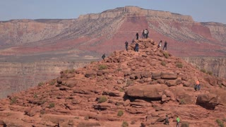 People climbing up rock mountain at West Rim of Grand Canyon 4k