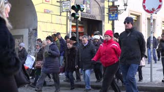 People crossing street in Prague slow motion.