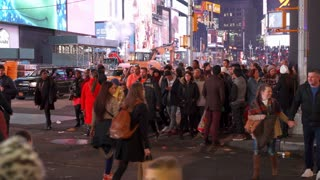 People crossing street in Times Square at night time lapse 4k