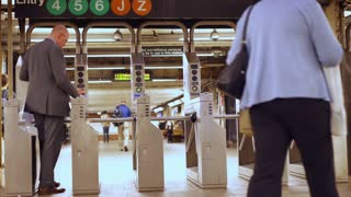 People entering and exiting turnstile in subway New York 4k