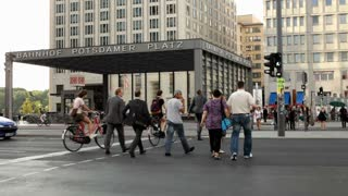 People in Berlin Germany crossing street