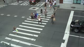 People in NYC from above crossing street slow motion
