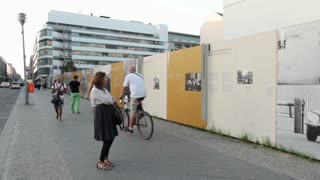 People looking at Berlin Wall memorial