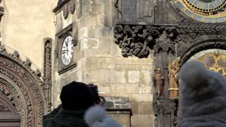 People looking at the Prague astronomical clock