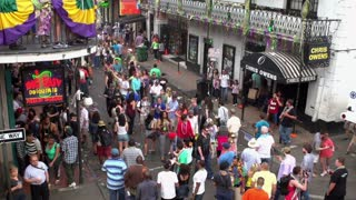 People on Bourbon street for Mardi Gras party