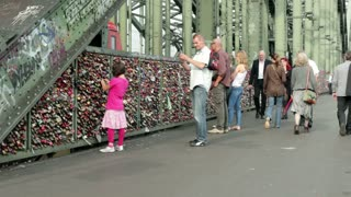 People on Locks of Love bridge in Cologne Germany