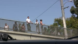 People on top of Overpass Watching Accident