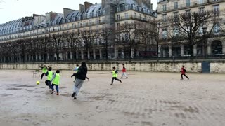 People playing soccer in Jardin des Tuileries Paris 720p