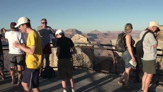 People posing in front of Grand Canyon