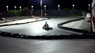 People racing on go kart track