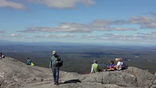 People relaxing at the top of Mount Monadnock